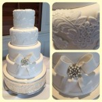4 tier ivory cake with white lace detail