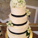 4 tier vanilla butter cream cake with fresh flowers