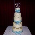 5 Tier choc wrap cake with pillars