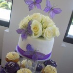 Close up of purple & silver cupcakes