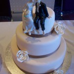 Elegant ivory roses and kissing couple