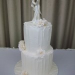 Extended height two tier cake in ivory