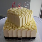 Gail & Adams white choc roses and ititial cake toppers