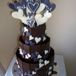 Michelle's engagement cake with choc chards and purple and white hearts