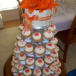 Orange flower & butterfly cupcakes