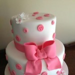 Pink button and bow cake