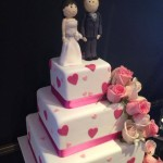 Pink love hearts on a 3 tier sqaure cake