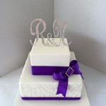 Pretty piping with purple bow and bling initials