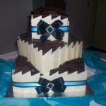 Square cake with black & blue ribbon and diamonte buckle