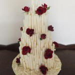 White choc curl mountain with fresh red roses