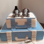 blue and white suitcases with elephants
