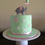 cute baby shower cake with elephant and snow flakes