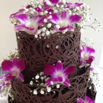 dark choc lace cake with purple orchids