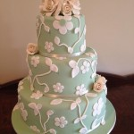 green fondant and ivory flowers and leaves