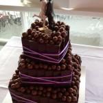 malteser cake with purple ribbon