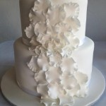 sugar white rose petals cascading down cake