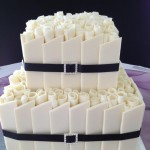 white choc rosettes with black ribbon and bling buckle